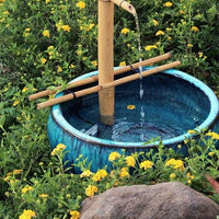 "Bamboo Accents 18"" Adjustable Spout & Pump Kit installed in garden fountain"