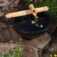"Bamboo Accents 18"" Three-Arm Spout & Pump Kit installed in black ceramic bowl"