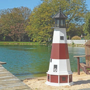 Octagonal Amish-Made Poly Montauk, NY Replica Lighthouse on the edge of a lake next to a pier