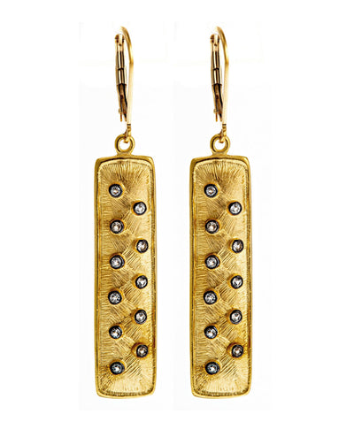 Gold bar earring with white topaz