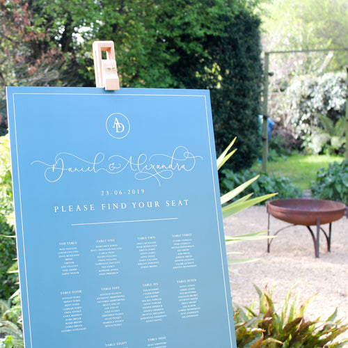 Light blue and white wedding seating chart