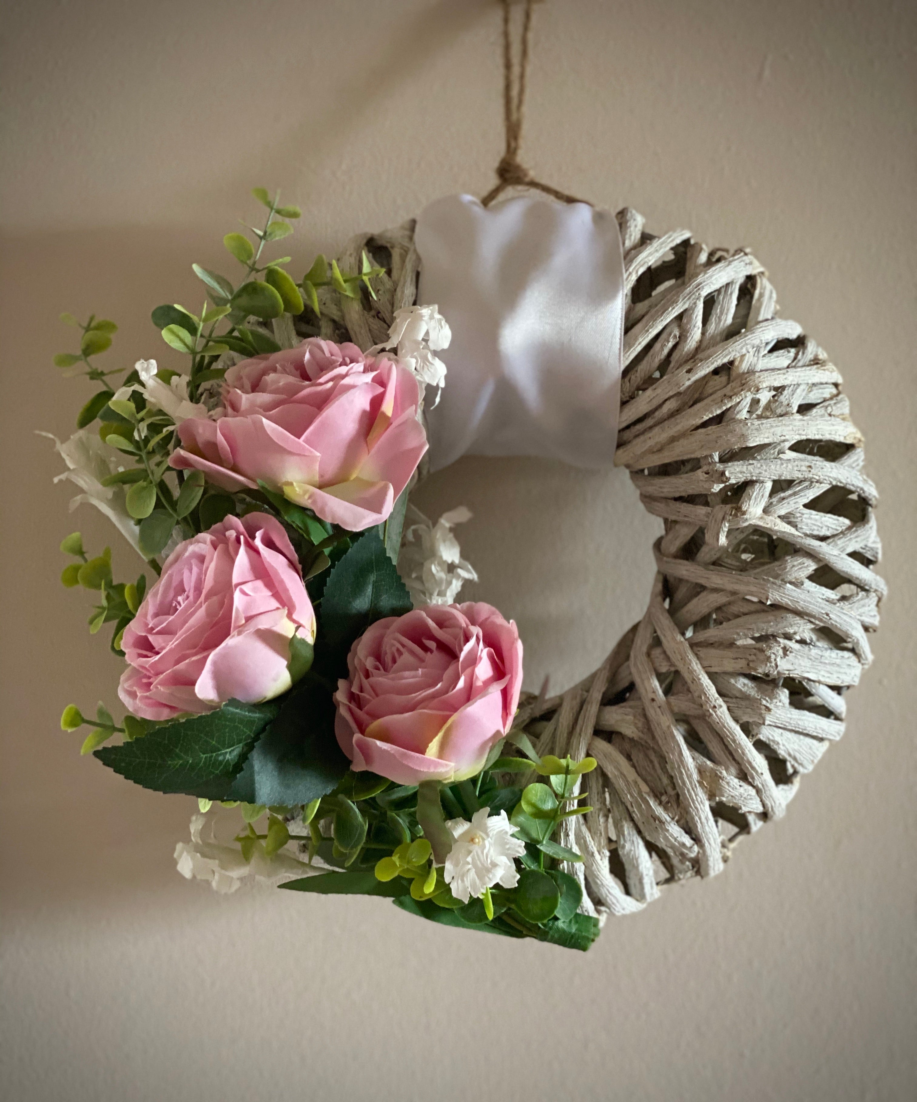 White Woven Wreath With Pink Roses