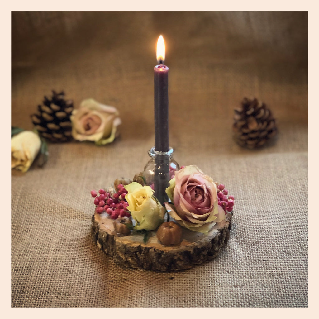 Candle holder, candle, log slice, dried flowers,
