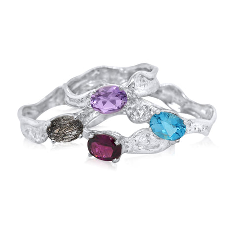 6x8mm East-West Oval Cut Ripple Ring_Rutilated Quartz_Amethyst_Blue Topaz_Rhodalite Garnet_Kristen Baird®