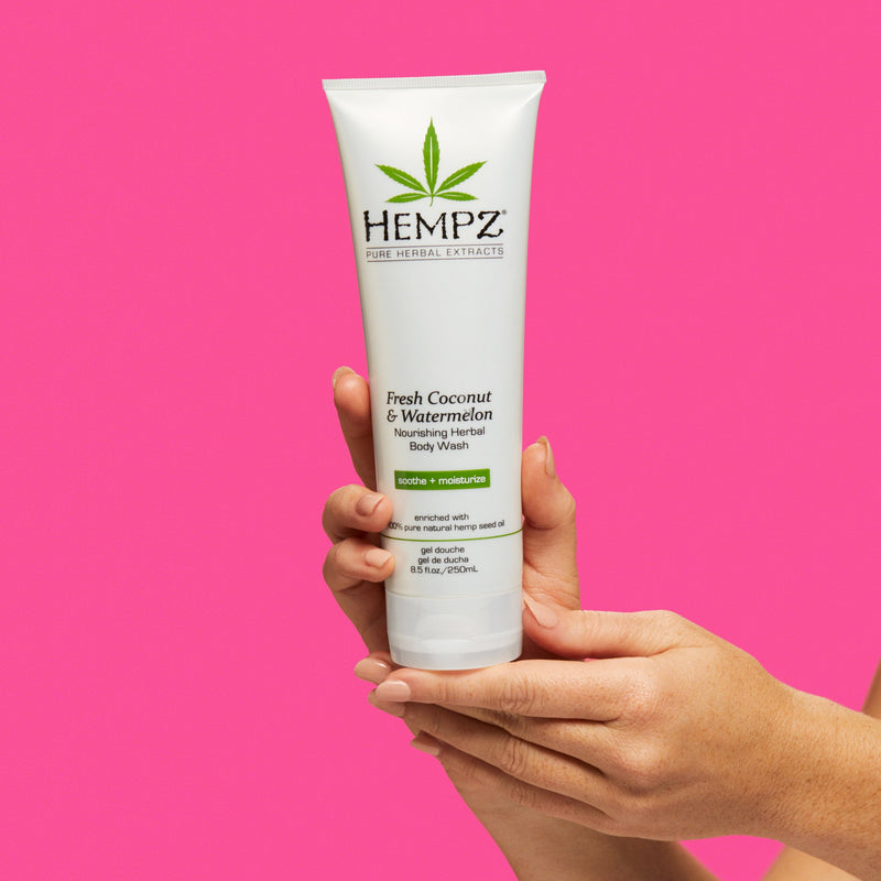 Model Holding Hempz Fresh Coconut & Watermelon Herbal Body Wash
