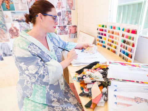 Photo of House of Lacuna founder & creative director Naomi Swalwell working in her studio.