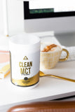 Levelup clean MCT powder on a desk with a latte