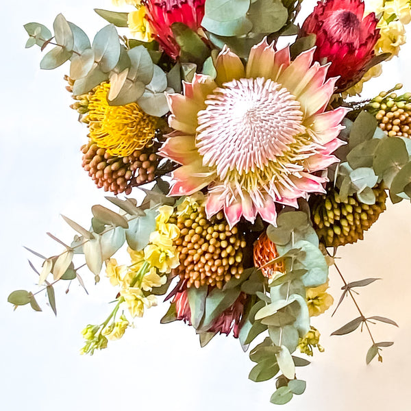 Emma Bouquet. King Protea, Eucalyptus/ Pennygum, Pincushions, Cream stock, Queen Proteas and Foliage.
