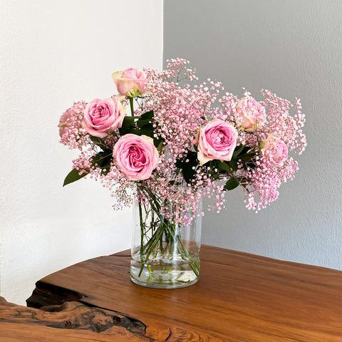 The Mia Bouquet includes 20+ stems of:  Blush roses and Gypsophila.