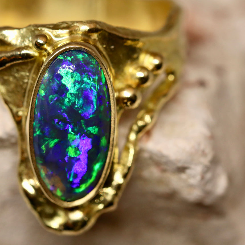'Molten' series - Black crystal opal, 18ct yellow gold.