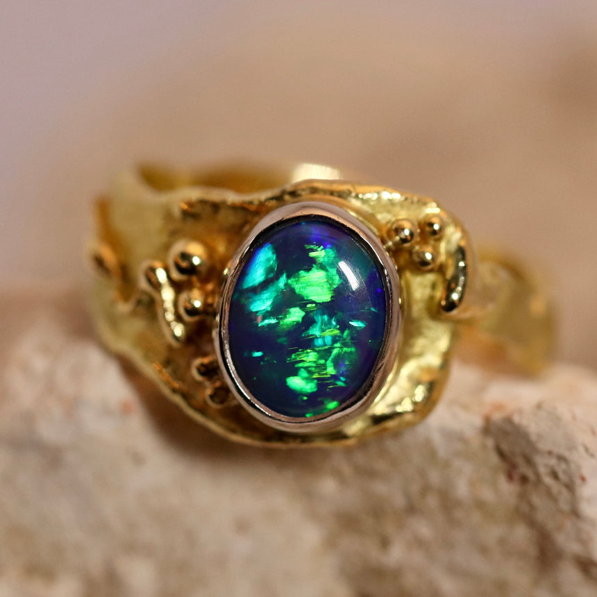'Molten' series - Black opal, 18ct yellow gold & palladium