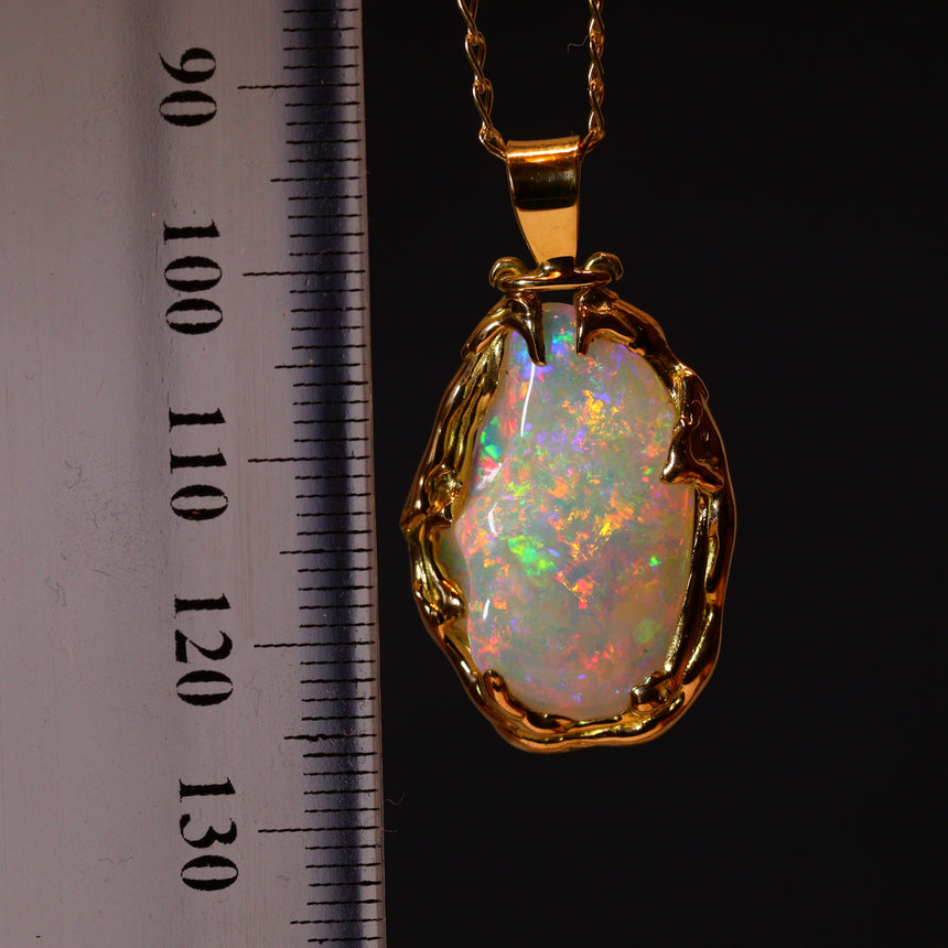 Opalised shell fossil & 18ct gold pendant