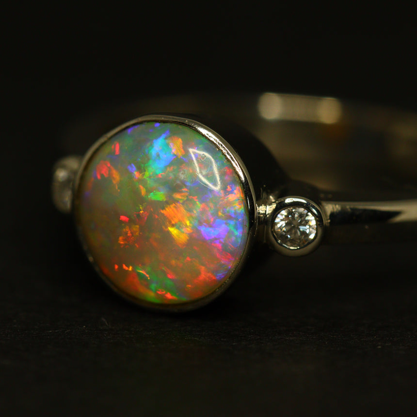 Lightning Ridge opal, platinum & diamond ring