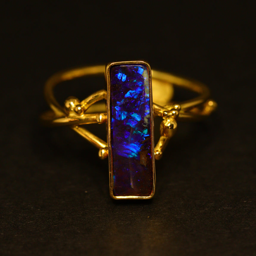 Electric blue boulder opal & 18ct gold ring
