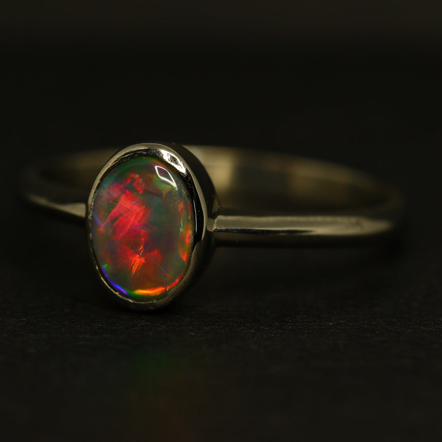 Black opal & platinum ring