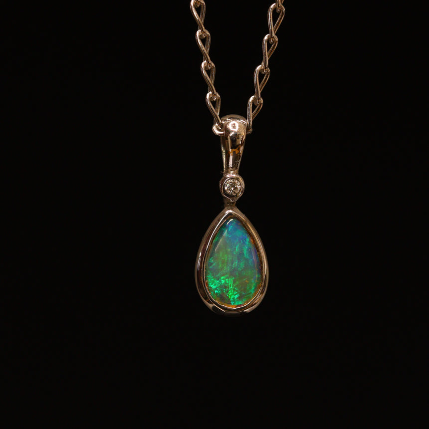Crystal opal, white gold & diamond pendant