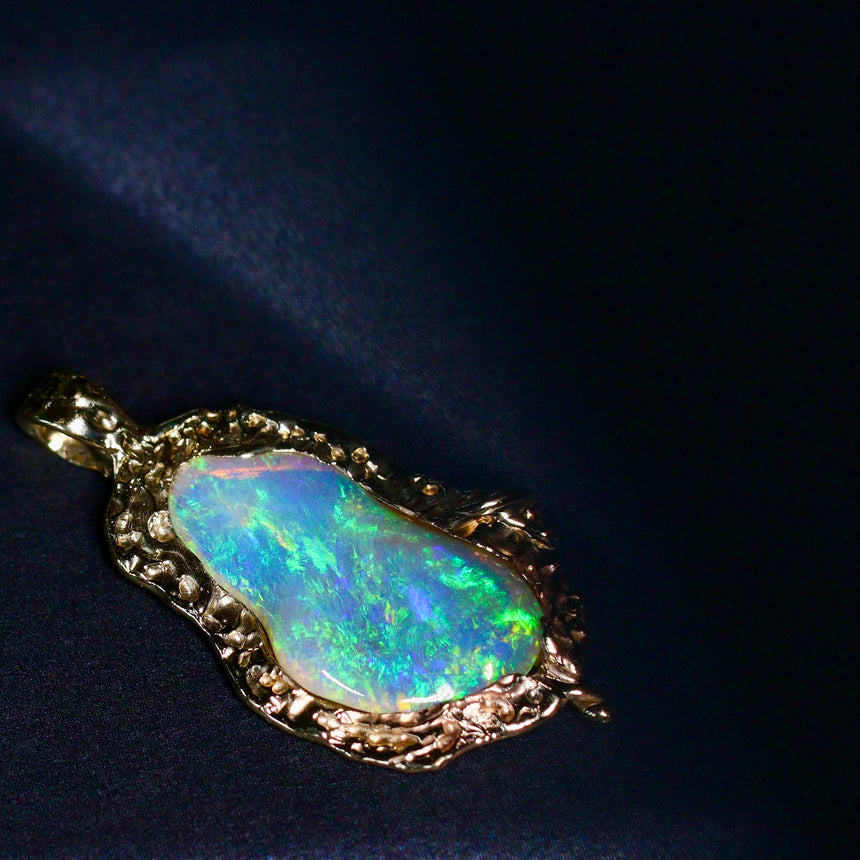 Crystal opal & gold pendant