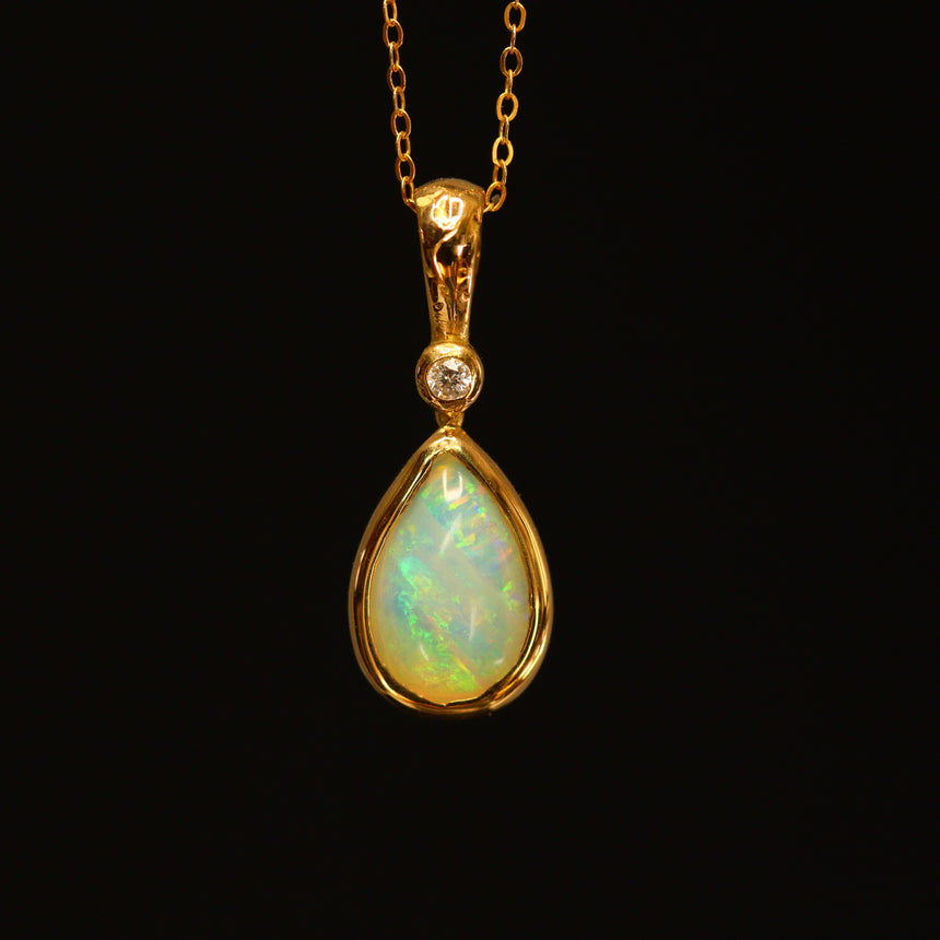 Crystal opal, 18ct gold & diamond pendant