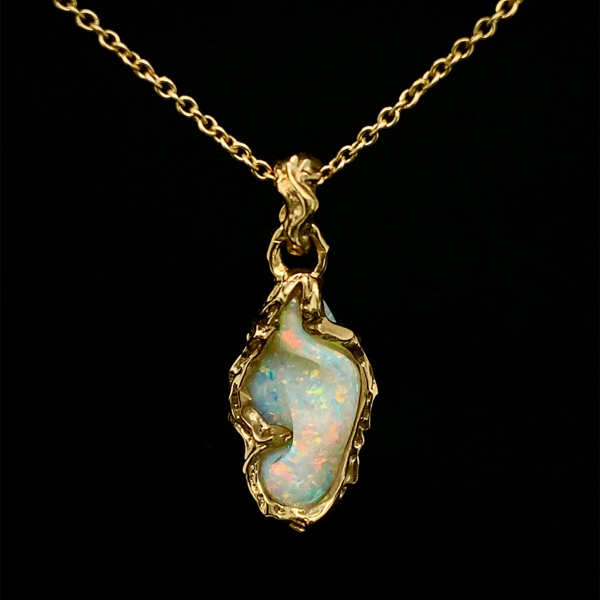 Opal carving & 18ct yellow gold pendant