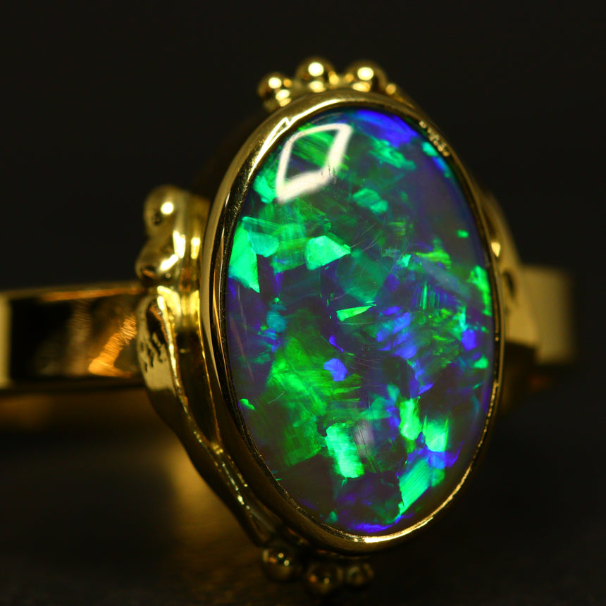 Gem black opal & 18ct yellow gold ring