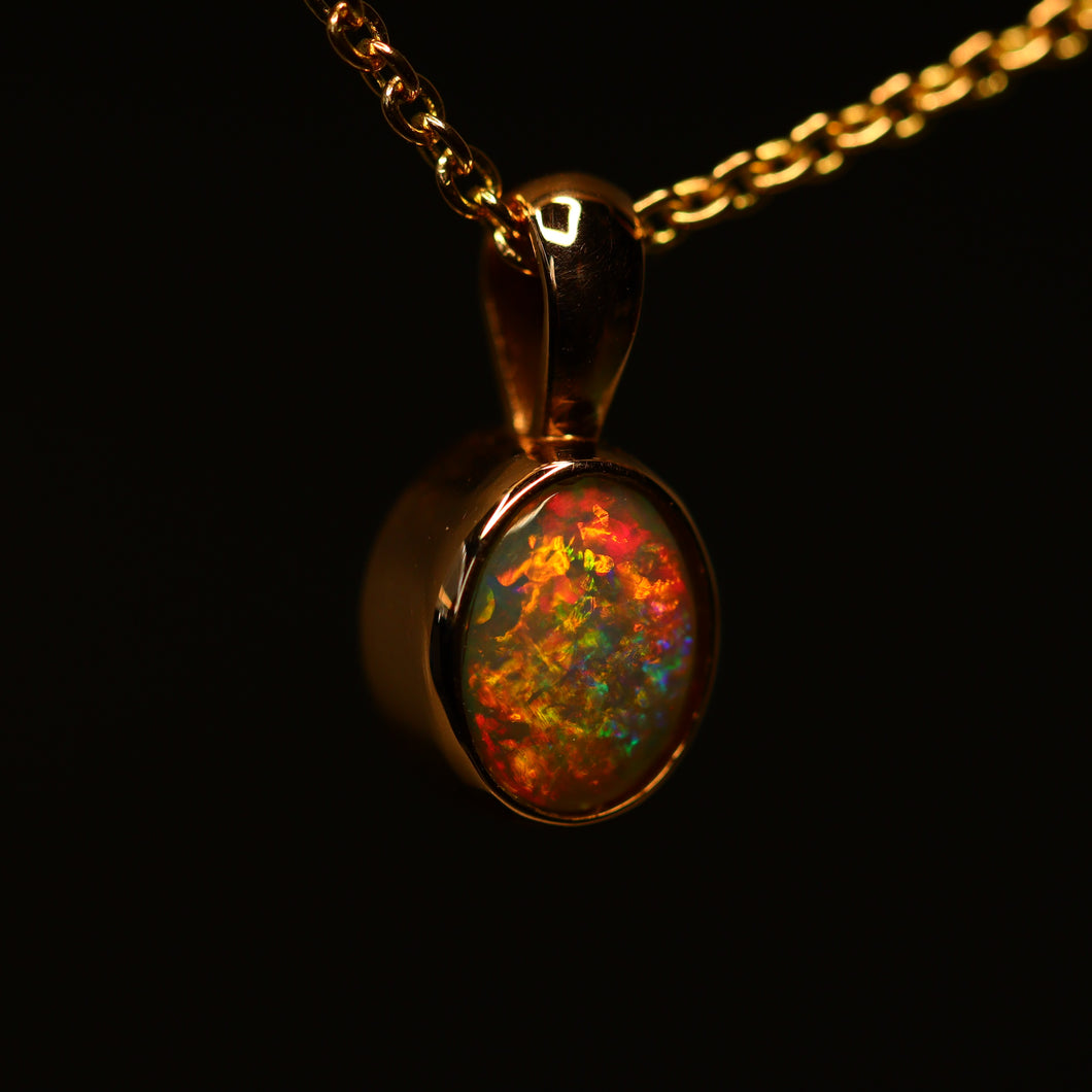 Lightning Ridge opal & rose gold pendant