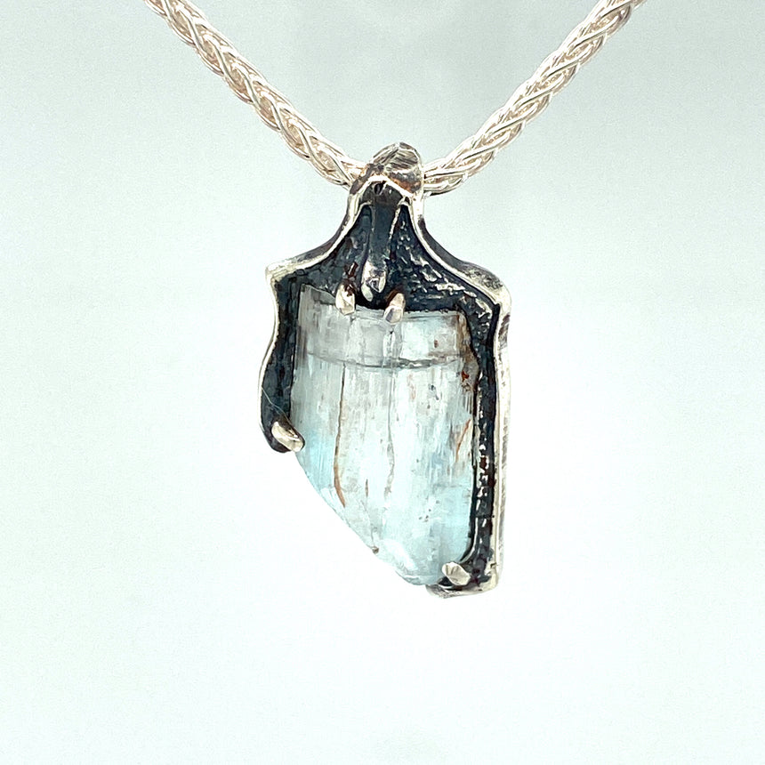 Topaz crystal and silver pendant