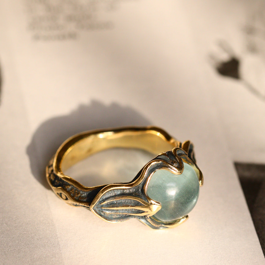 Black gold & aquamarine ring