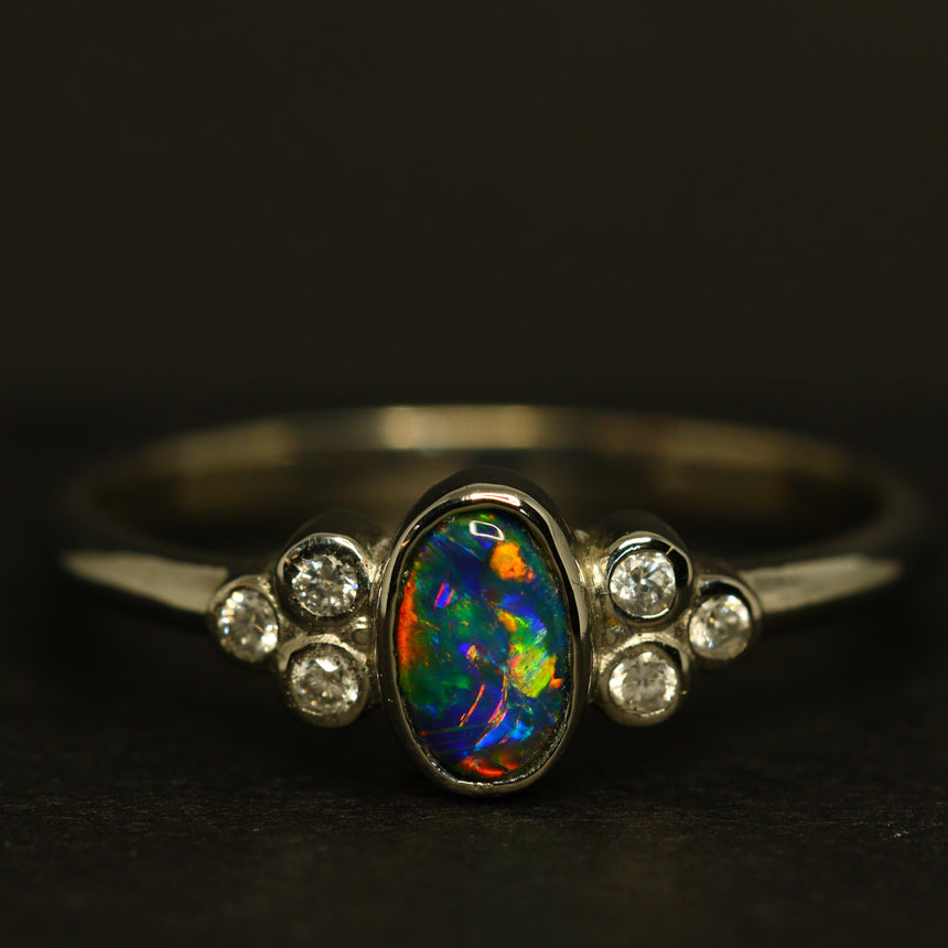 Black opal platinum ring with diamonds