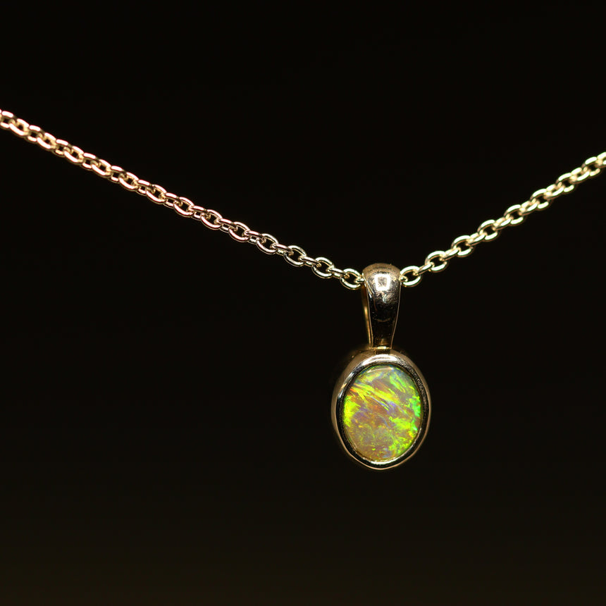 Lightning Ridge opal & white gold pendant