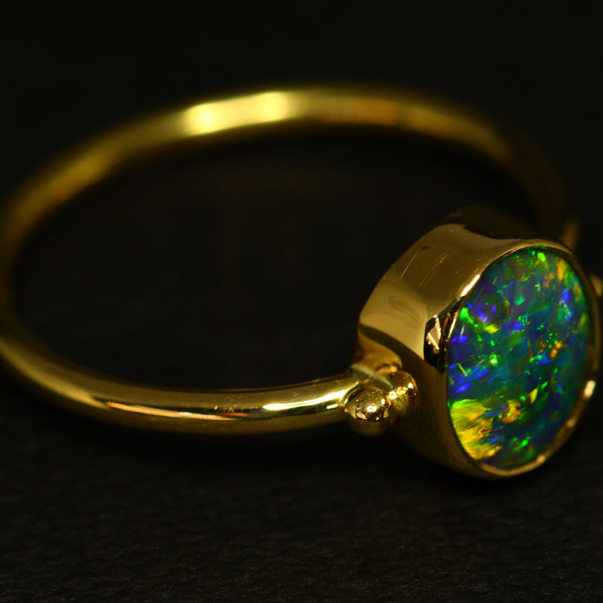 Black opal & 18ct gold ring