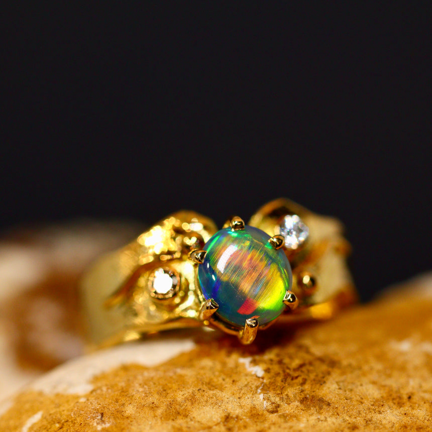 Black crystal opal, diamonds & 18ct gold ring