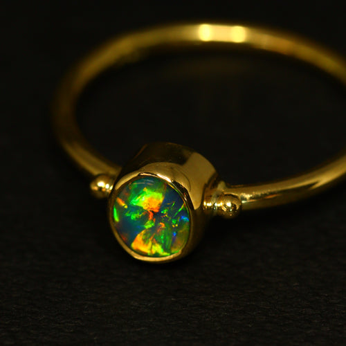 Gem black opal & 18ct gold ring