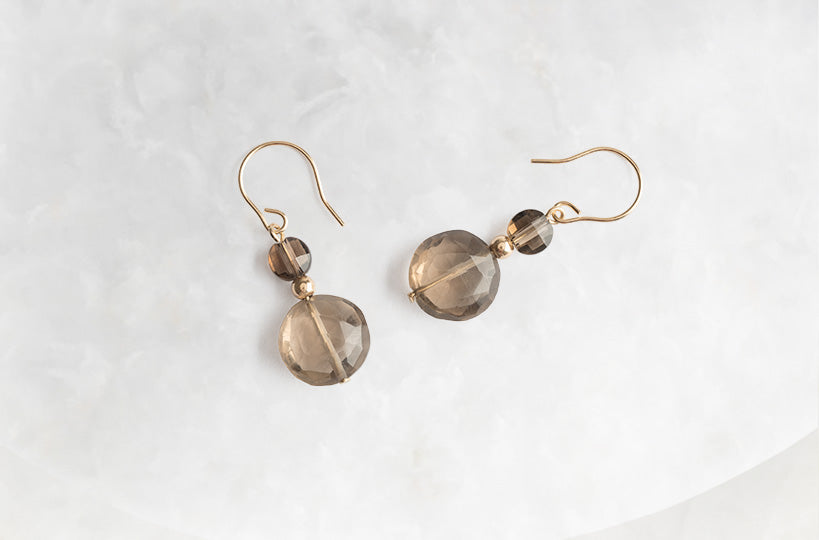 These 14k gold earrings with smoky quartz will empower you to take the first steps to living to the fullest. Get your pair today!