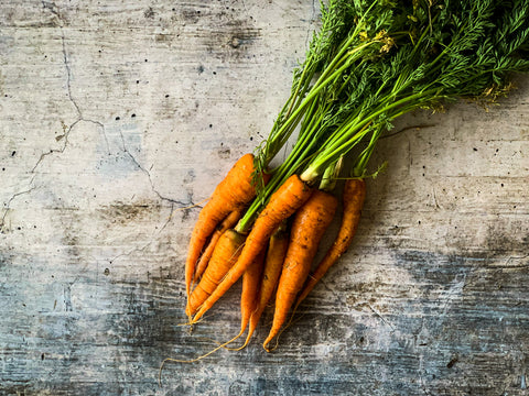 Carrots on texture background