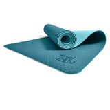Yogibato Yoga Mat Balance Ocean partially rolled up showing non-slip surface and bottom from profile angle