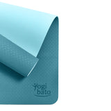 Yogibato Yoga Mat Balance Ocean partially rolled up showing non-slip surface and bottom from above