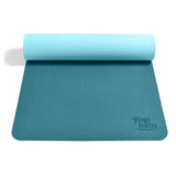 Yogibato Yoga Mat Balance Ocean partially rolled up showing non-slip surface and bottom for yoga practice