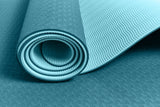 Yogibato Yoga Mat Balance Ocean partially rolled up showing non-slip surface and bottom with close up of structure