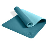 Yogibato Yoga Mat Balance Ocean partially rolled up showing non-slip surface and bottom with carry strap