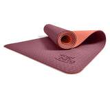 Yogibato Yoga Mat Balance Coral partially rolled up showing non-slip surface and bottom from profile angle