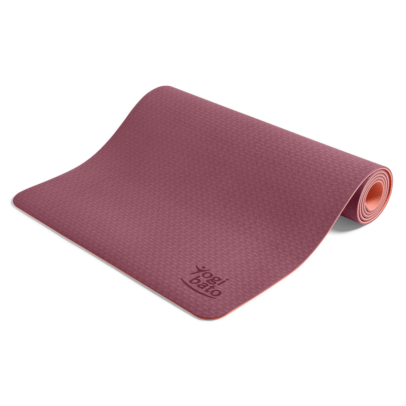 Yogibato Yoga Mat Balance Coral partially rolled up showing non-slip surface and bottom from above