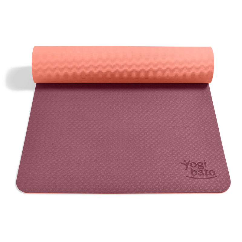 Yogibato Yoga Mat Balance Coral partially rolled up showing non-slip surface and bottom for yoga practice