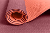 Yogibato Yoga Mat Balance Coral partially rolled up showing non-slip surface and bottom with close up of structure
