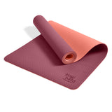 Yogibato Yoga Mat Balance Coral partially rolled up showing non-slip surface and bottom with carry strap