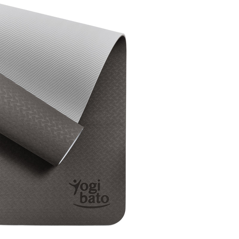 Yogibato Yoga Mat Balance Midnight partially rolled up showing non-slip surface and bottom from above