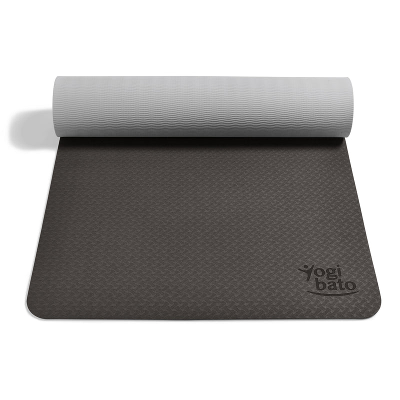Yogibato Yoga Mat Balance Midnight partially rolled up showing non-slip surface and bottom for yoga practice