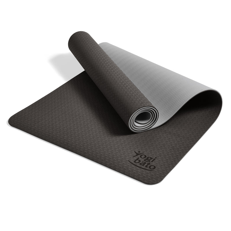 Yogibato Yoga Mat Balance Midnight partially rolled up showing non-slip surface and bottom with carry strap