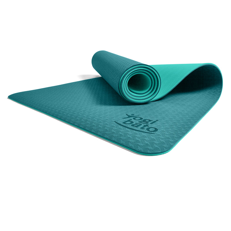 Yogibato Yoga Mat Balance Emerald partially rolled up showing non-slip surface and bottom from profile angle