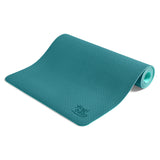 Yogibato Yoga Mat Balance Emerald partially rolled up showing non-slip surface and bottom from the side