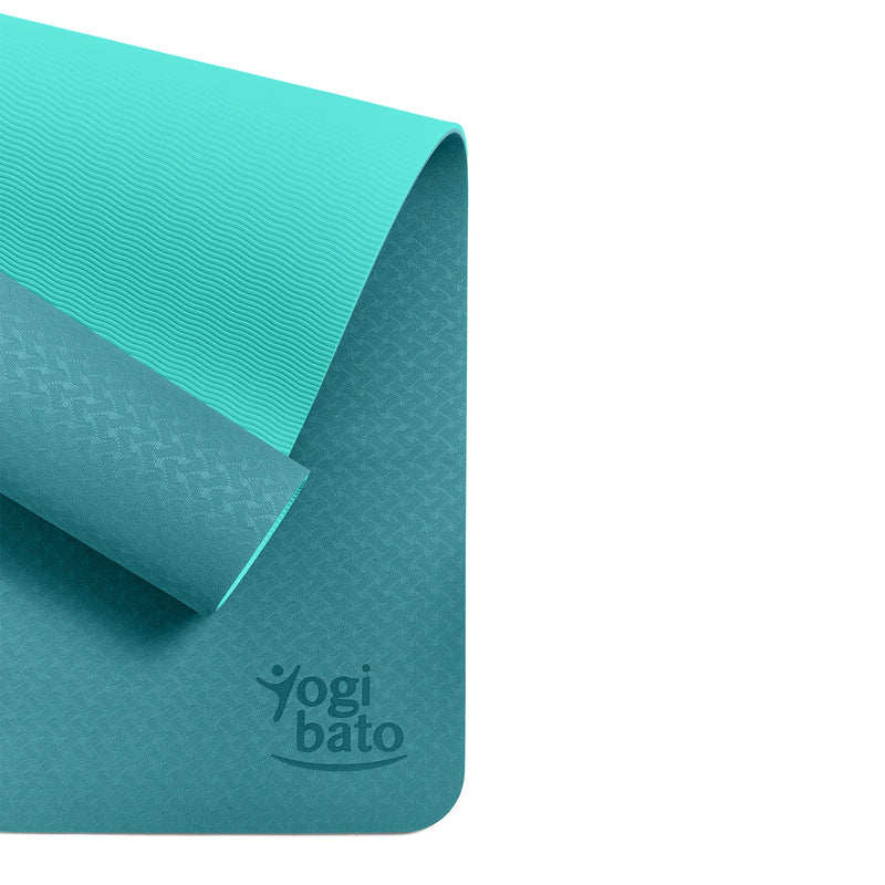 Yogibato Yoga Mat Balance Emerald partially rolled up showing non-slip surface and bottom from above
